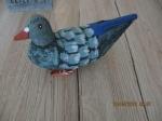 houten duif, staart is van riet